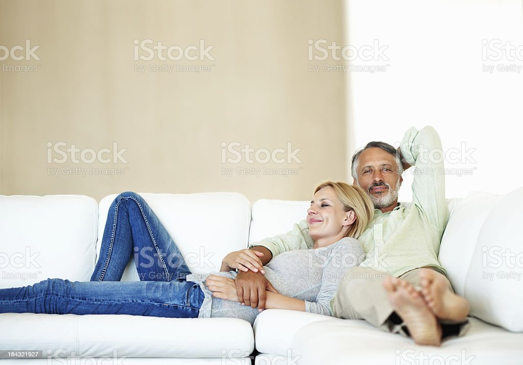 Mature couple resting on sofa royalty-free stock photo