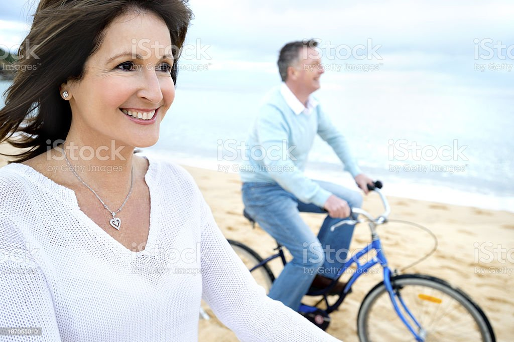 Mature couple riding bicycles royalty-free stock photo