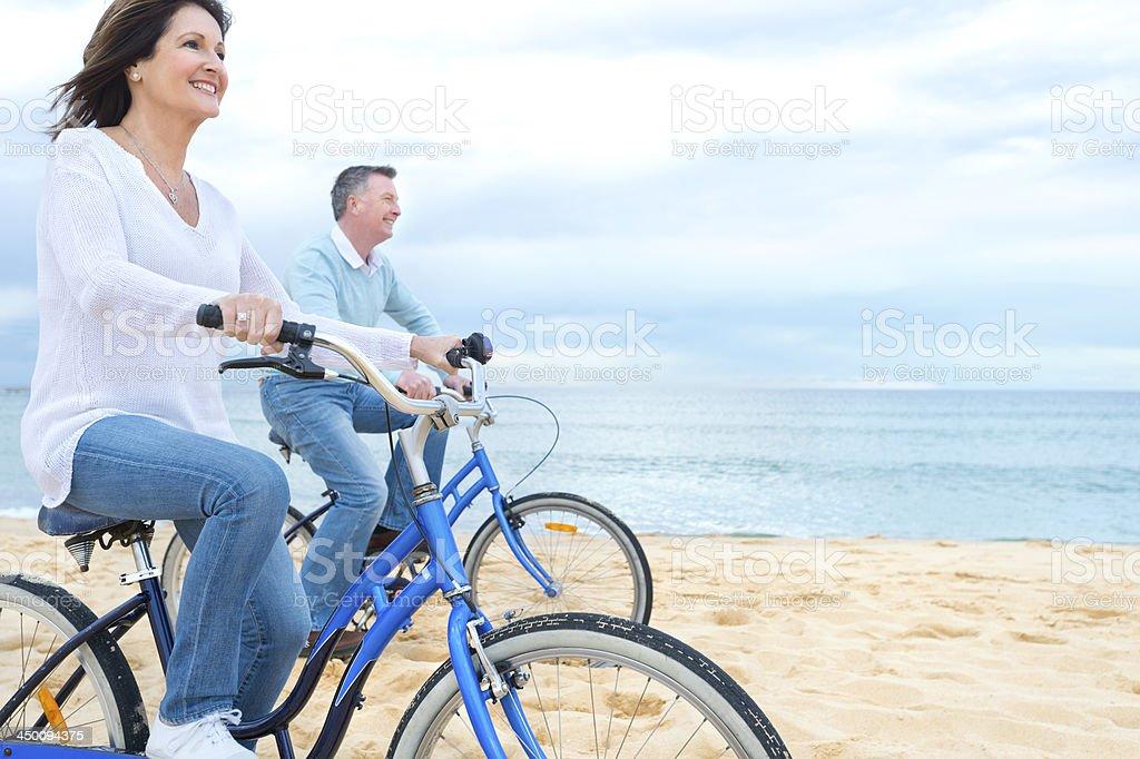 Mature couple riding bicycles stock photo