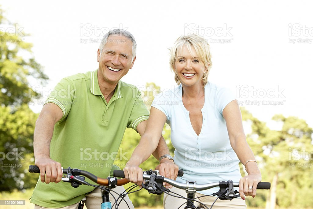 Mature couple riding bikes royalty-free stock photo