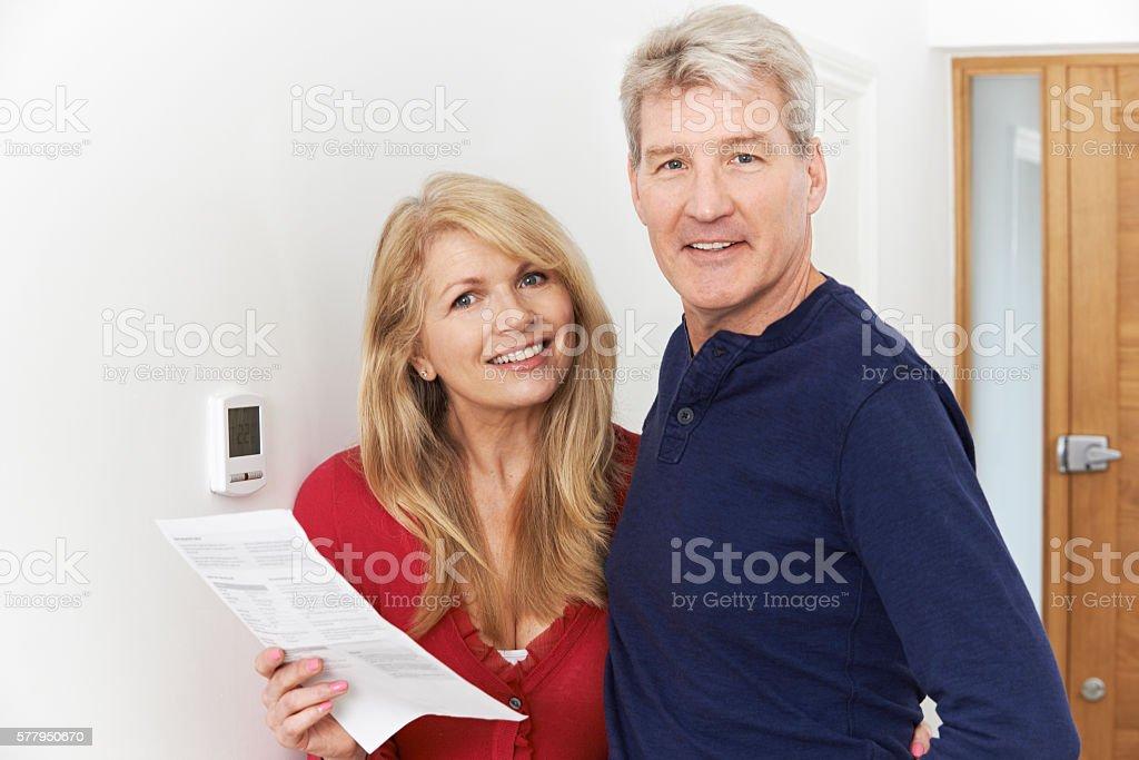 Mature Couple Saving Money On Domestic Heating Bills stock photo