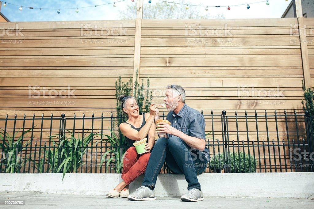 Mature Couple Sharing Ice Cream stock photo