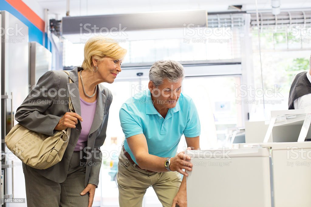 Mature couple shopping for appliances stock photo