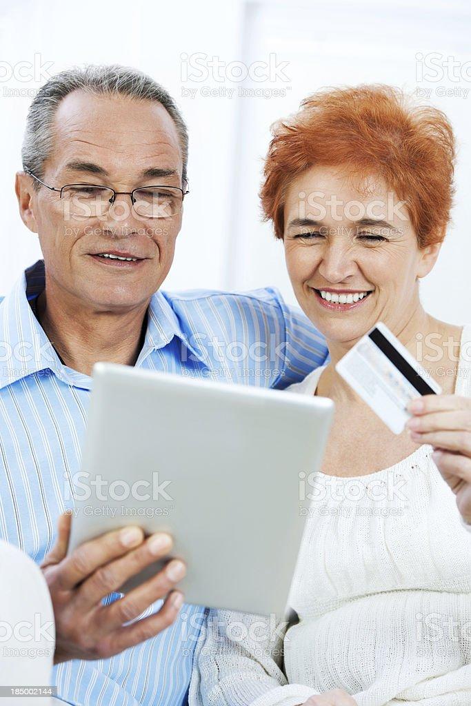 Mature couple shopping on internet. royalty-free stock photo