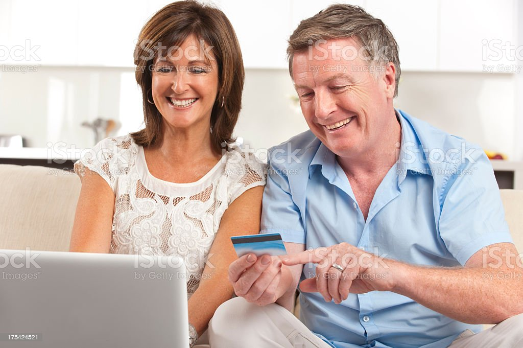 Mature couple shopping online royalty-free stock photo