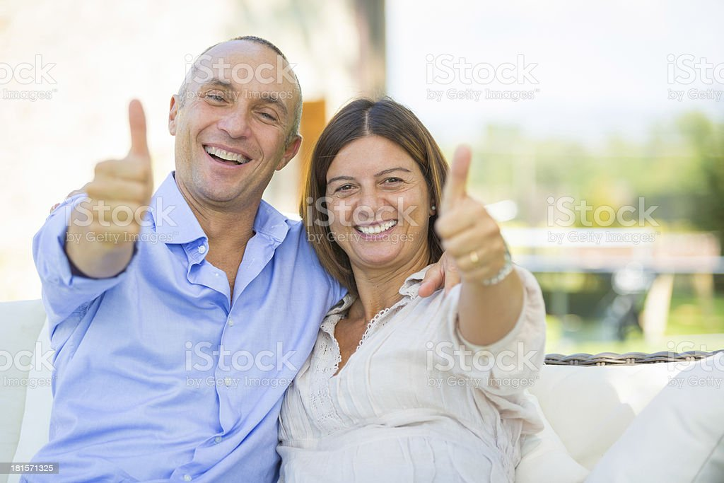 Mature Couple Showing Thumbs Up royalty-free stock photo