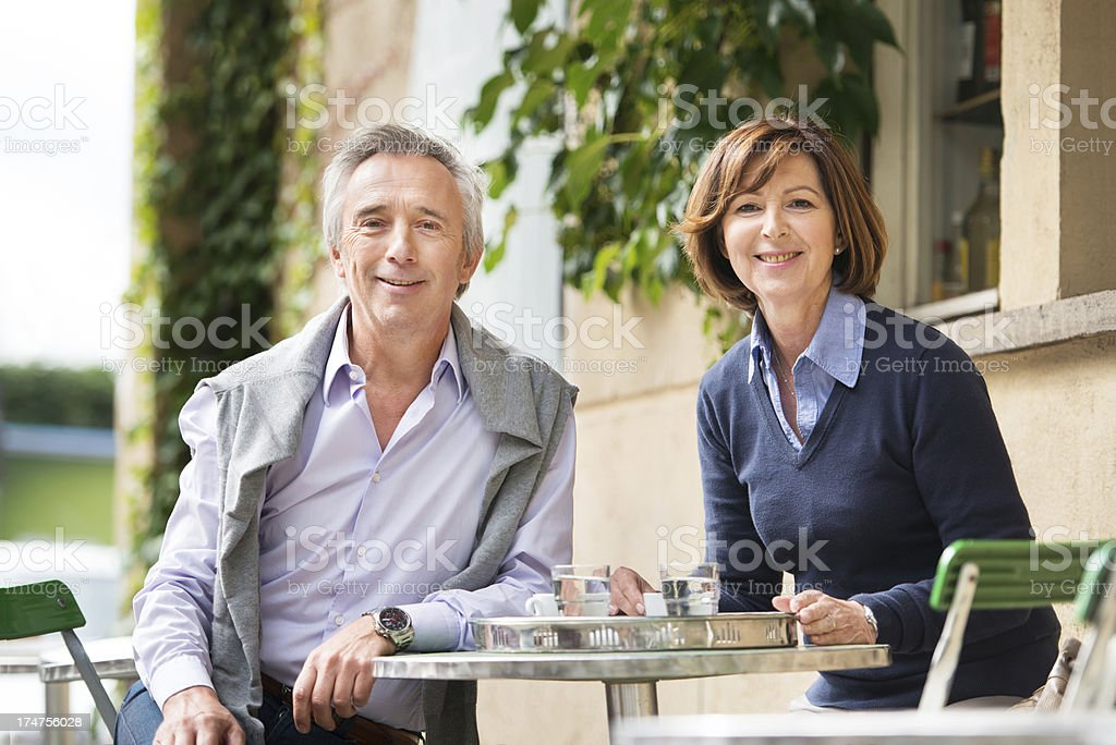 Mature Couple Sitting Outside a Cafe stock photo