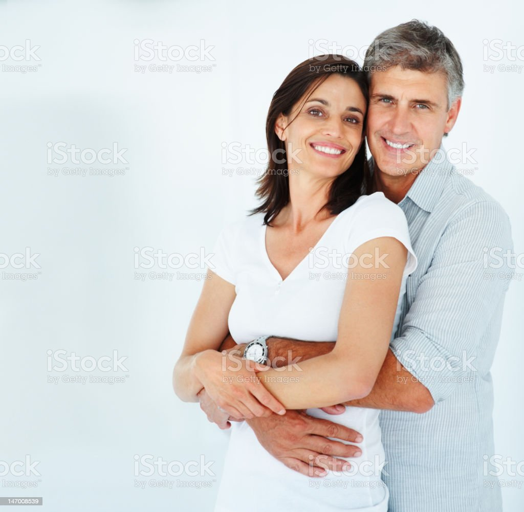 Mature couple smiling and embracing royalty-free stock photo
