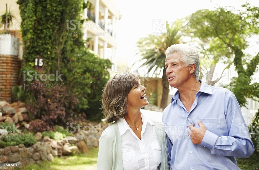 Mature couple standing in a garden royalty-free stock photo