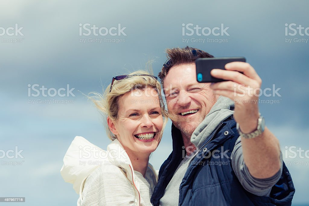 Mature couple taking a selfie stock photo