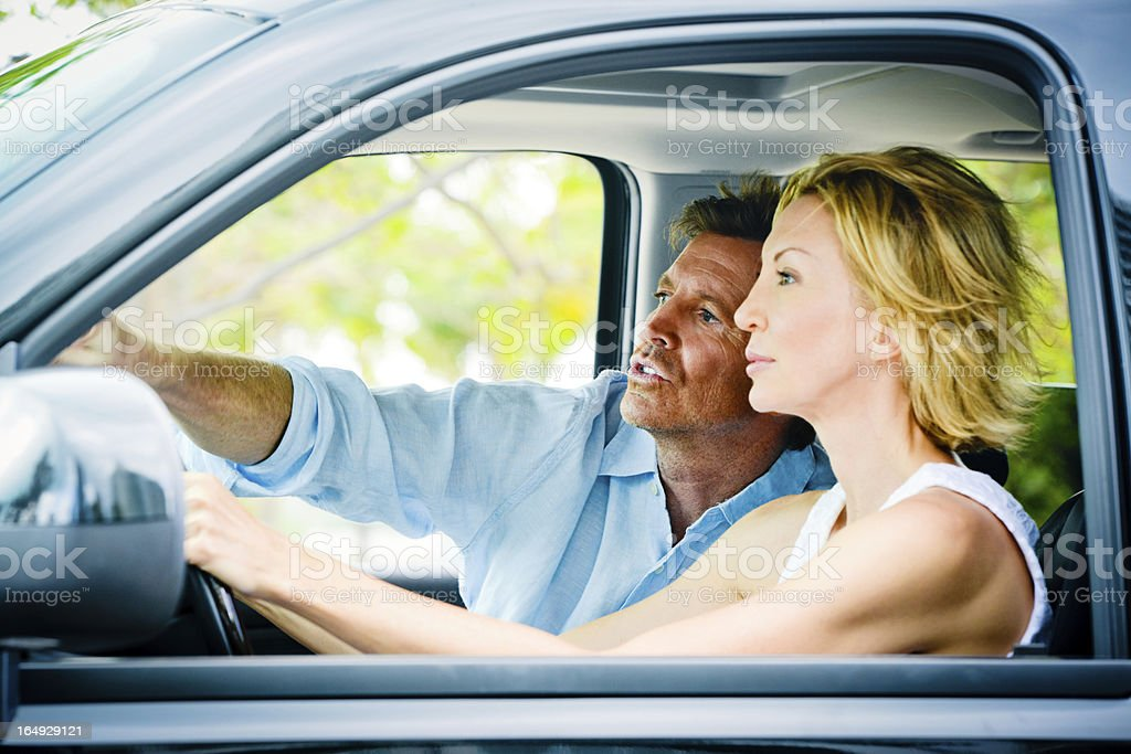 Mature Couple traveling by car royalty-free stock photo