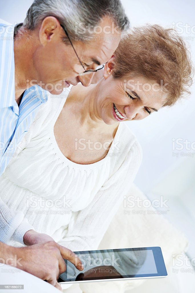 Mature couple using a touch pad. royalty-free stock photo