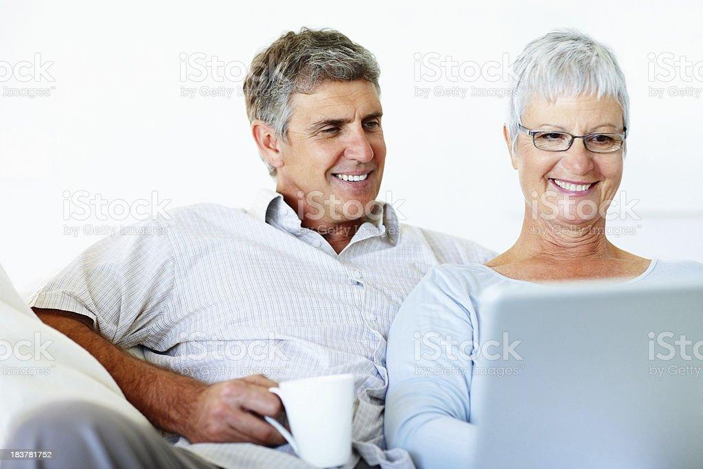 Mature couple using laptop royalty-free stock photo