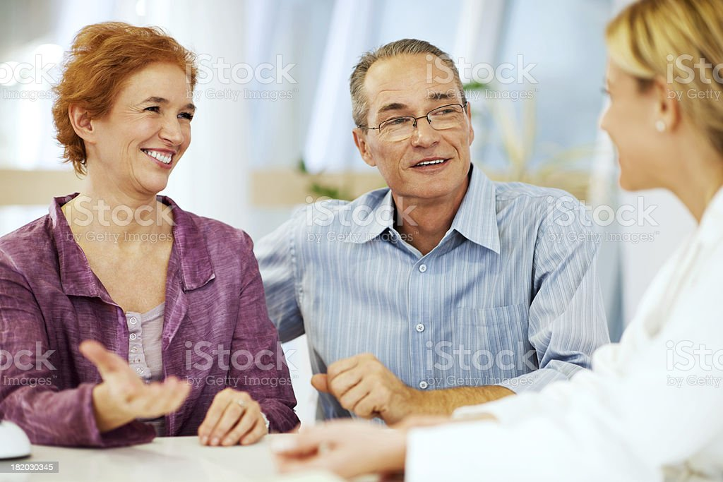 Mature couple visiting a doctor. stock photo