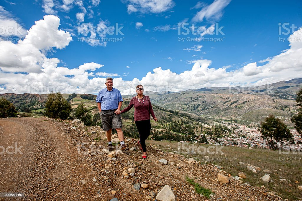 Mature couple walking in the Andes countryside above Huaraz stock photo