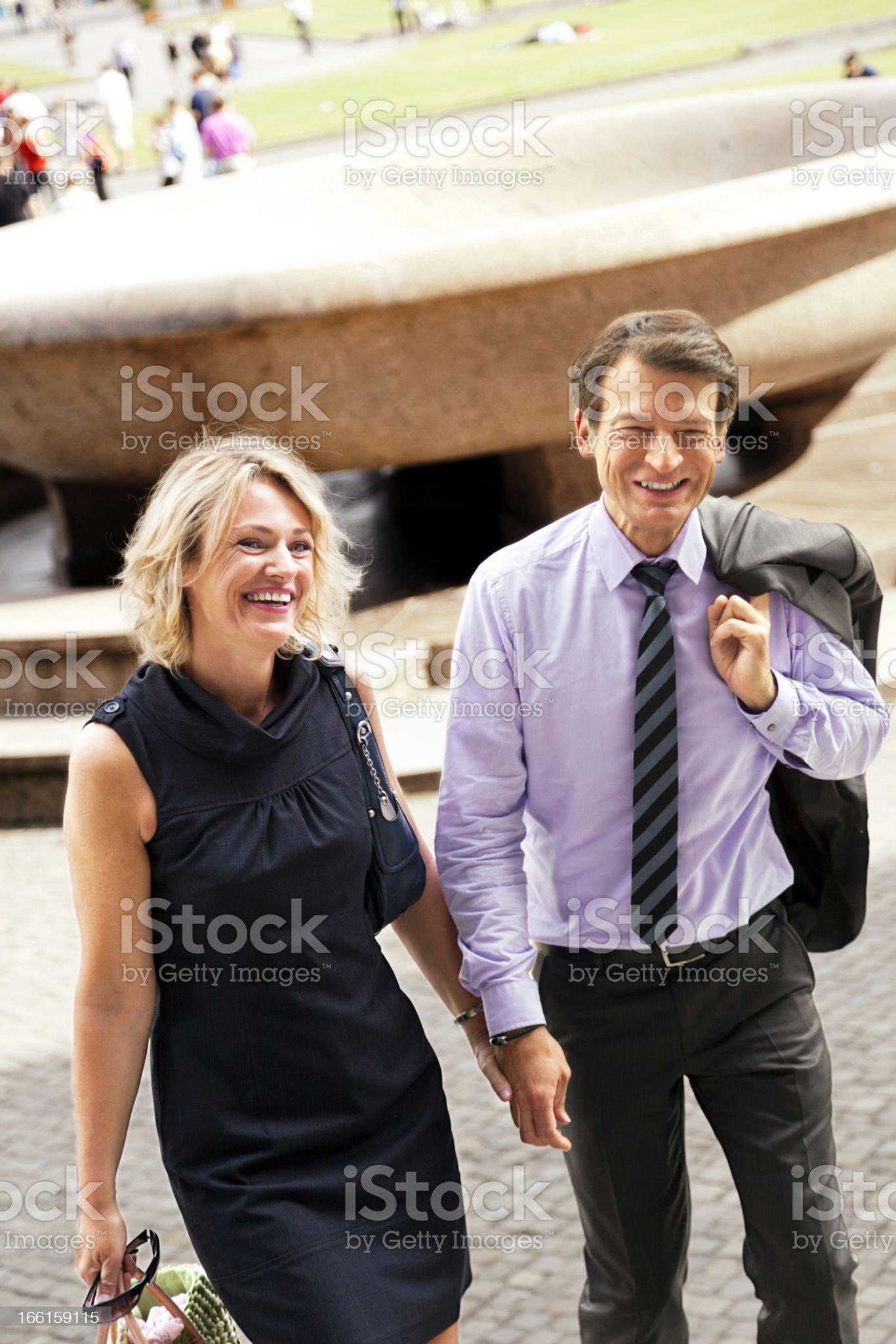 Mature Couple Walking in Urban Setting royalty-free stock photo