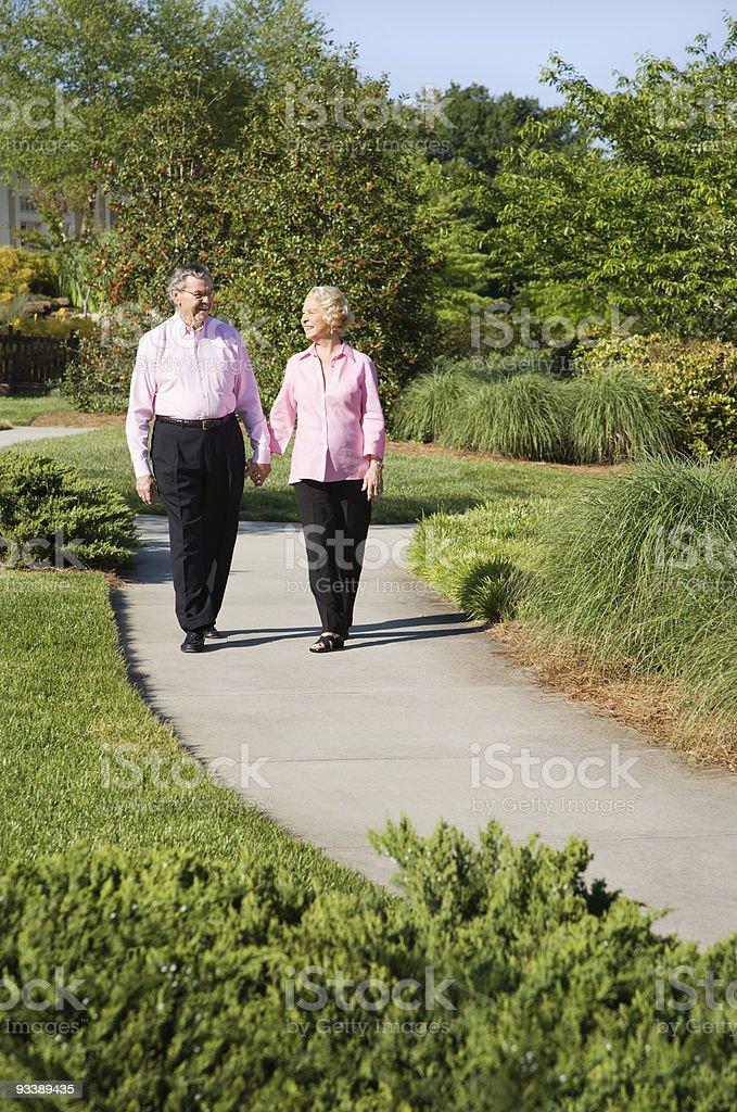 Mature couple walking. royalty-free stock photo