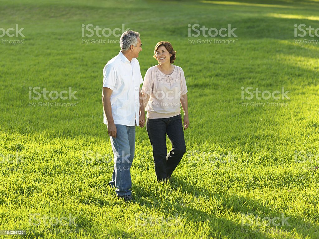 Mature couple walking together royalty-free stock photo
