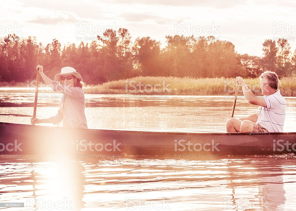 Mature Couple with a Healthy Lifestyle Canoeing royalty-free stock photo
