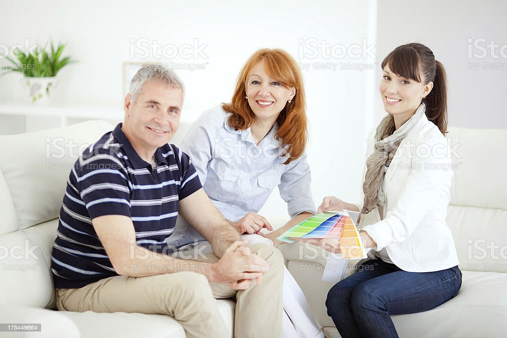 Mature couple with consultant. royalty-free stock photo