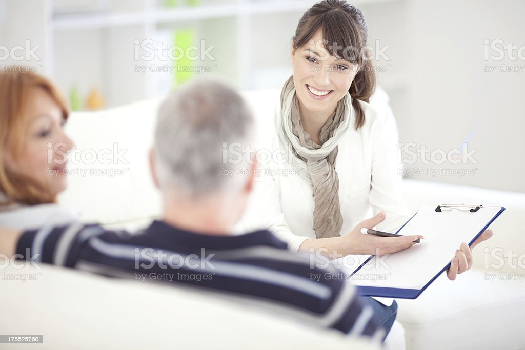 Mature couple with consultant. stock photo