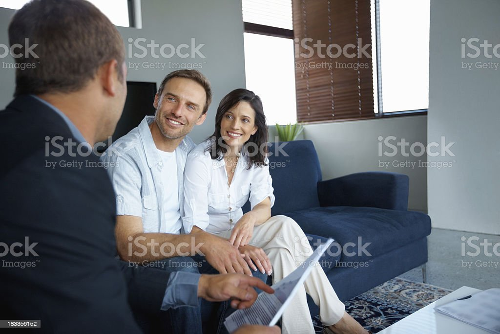 Mature couple with consultant royalty-free stock photo