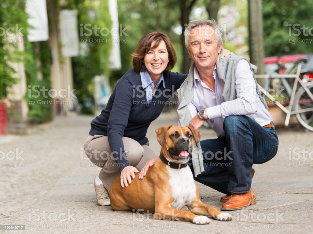 Mature Couple with Dog stock photo