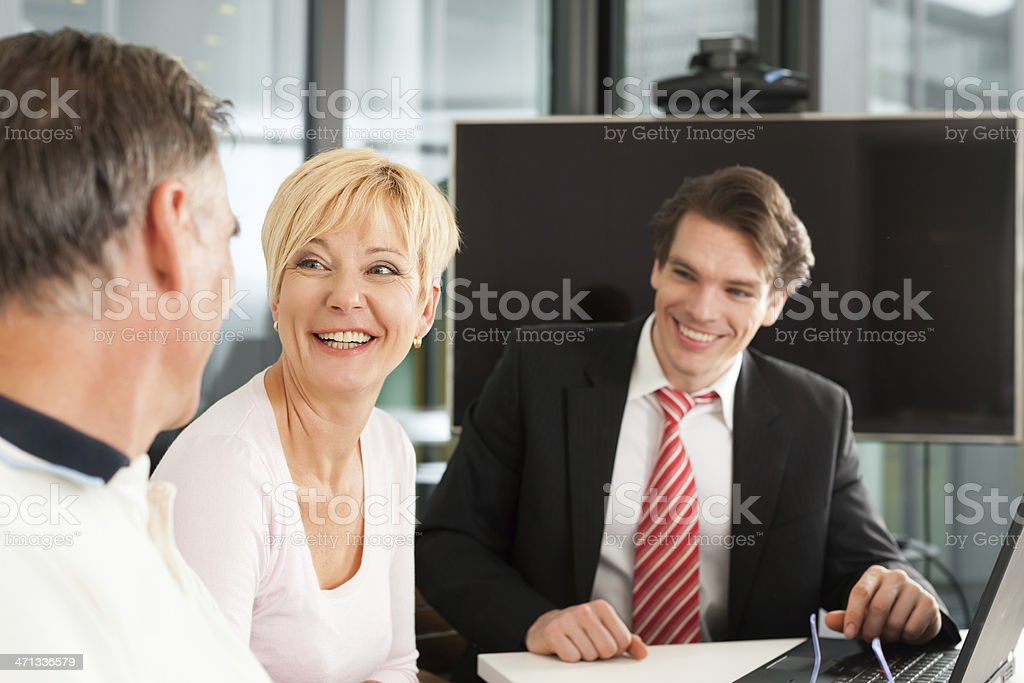 Mature couple with financial consultant royalty-free stock photo