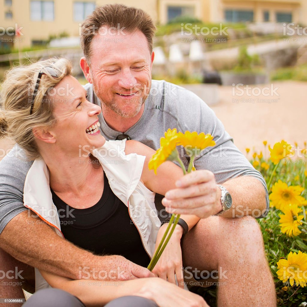 Mature Couple with Flowers stock photo