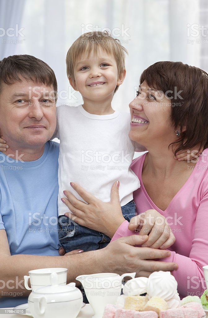Mature couple with grandchild royalty-free stock photo