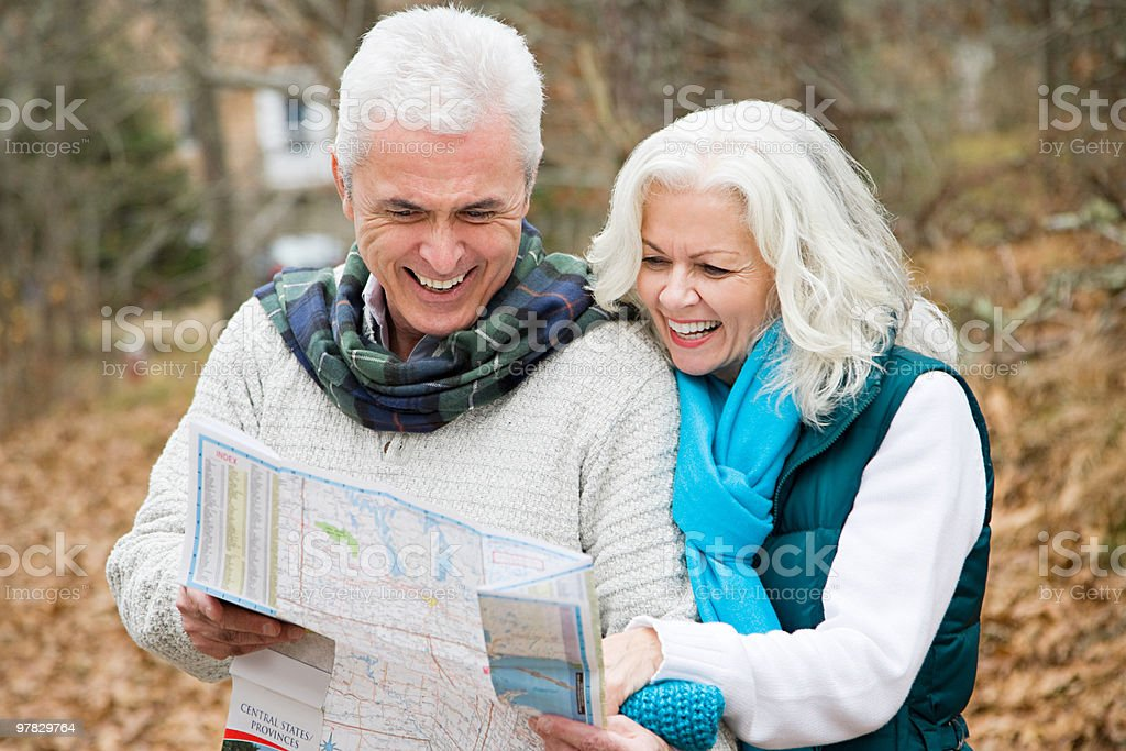Mature couple with map royalty-free stock photo