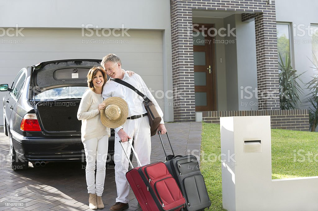 Mature couple with suitcases and car stock photo