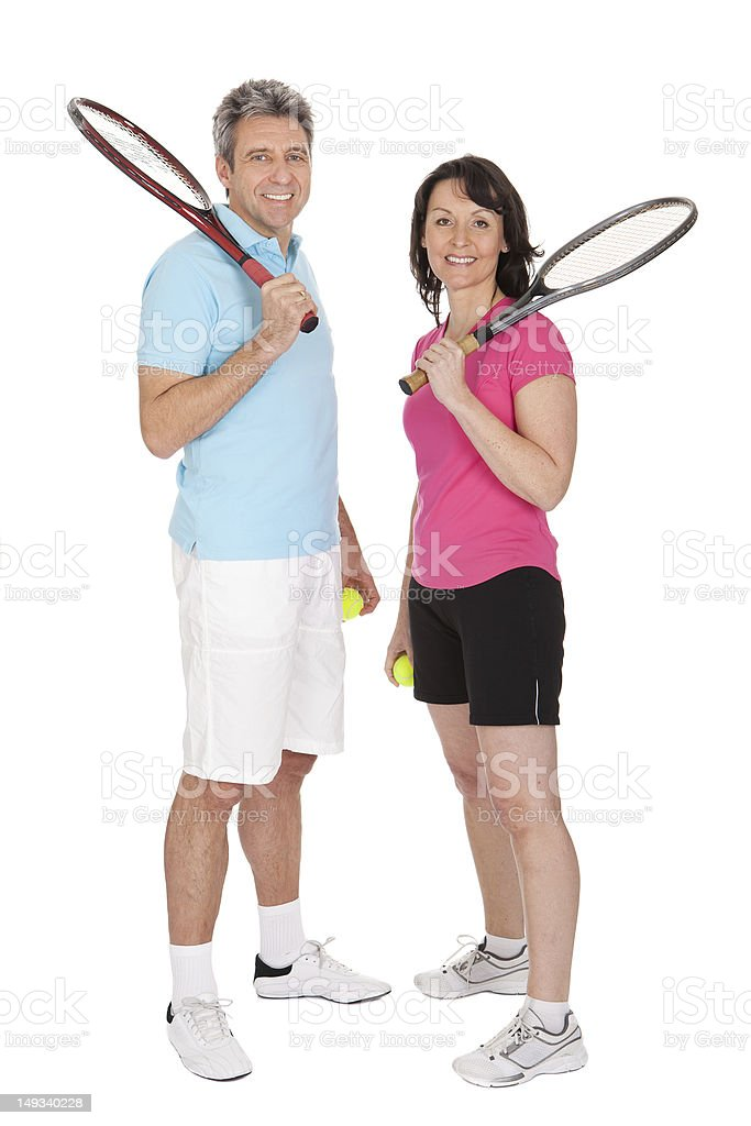 Mature couple with tennis racquets royalty-free stock photo