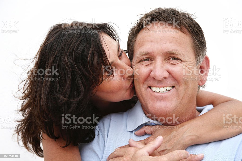 Mature couple Woman hugging and kissing a smiling man  royalty-free stock photo
