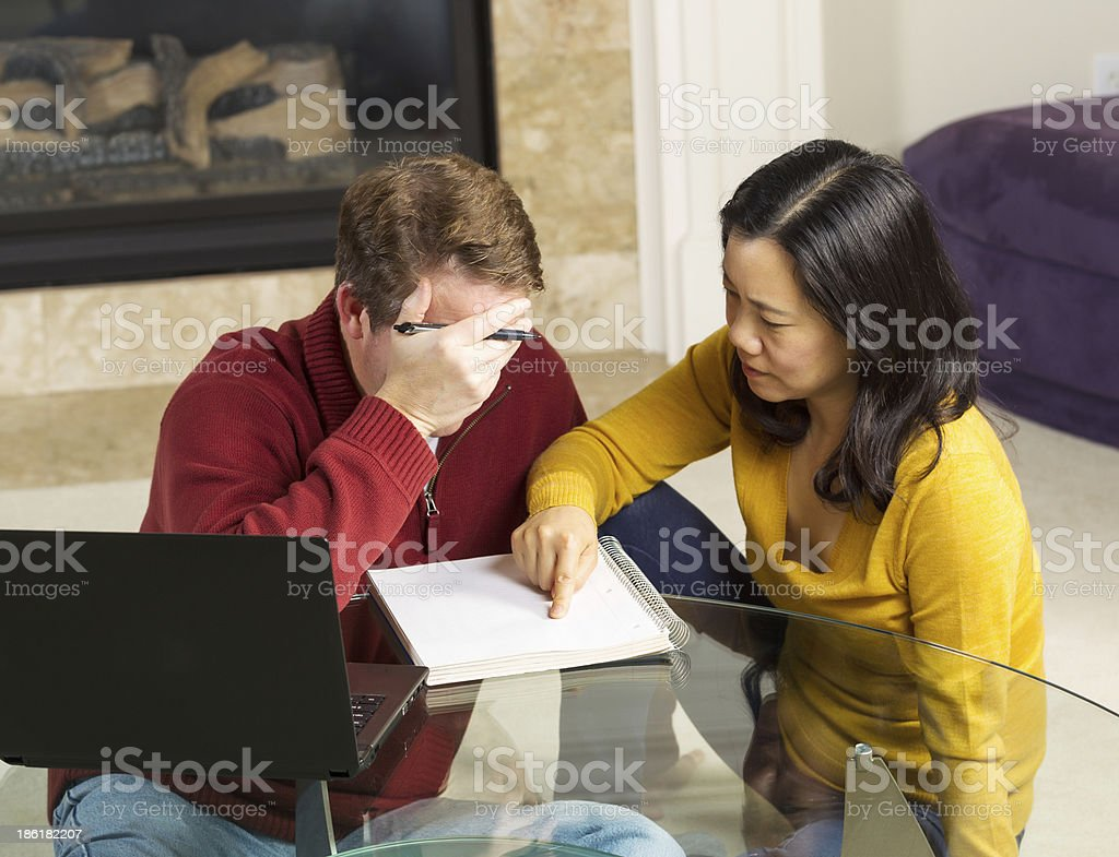 Mature Couple working on Urgent Matter from thier Home royalty-free stock photo