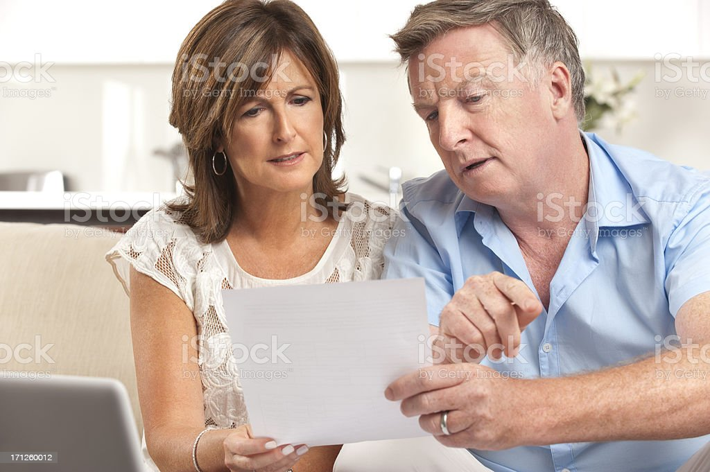 Mature couple worrying about finances stock photo