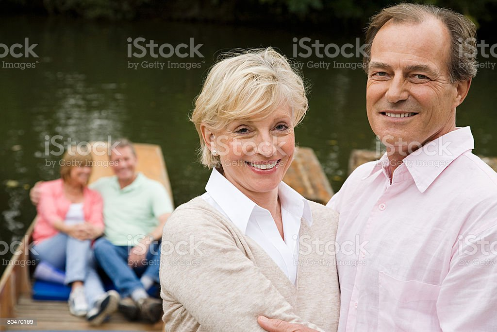 Mature couples on boating trip stock photo