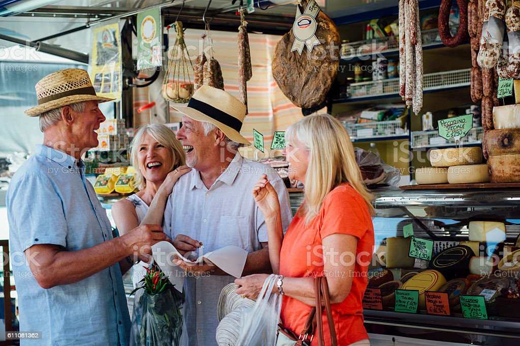 Mature Couples Shopping in an Italian Delicatessen stock photo