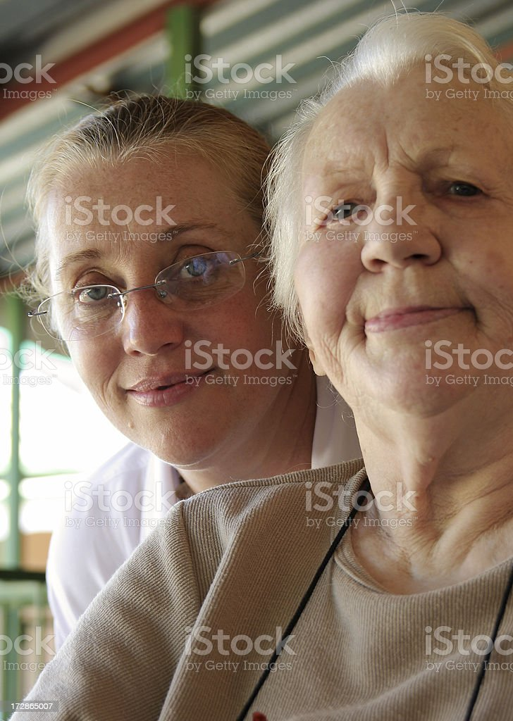 Mature daughter and aged mother royalty-free stock photo