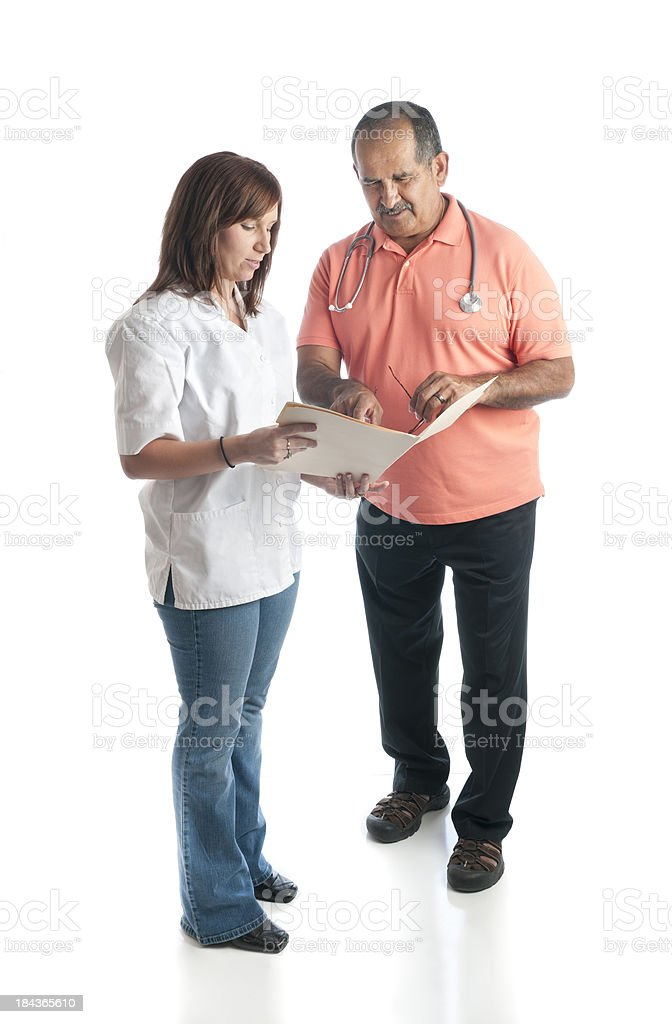 Mature Doctor and Medical Assistant Checking Chart royalty-free stock photo