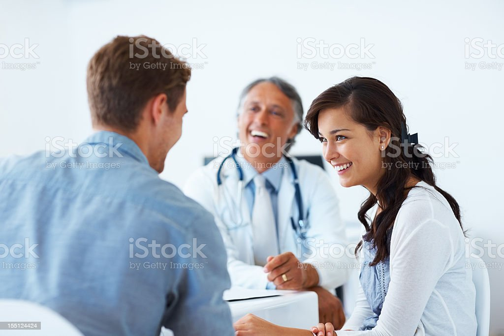 Mature doctor and patients having a conversation stock photo