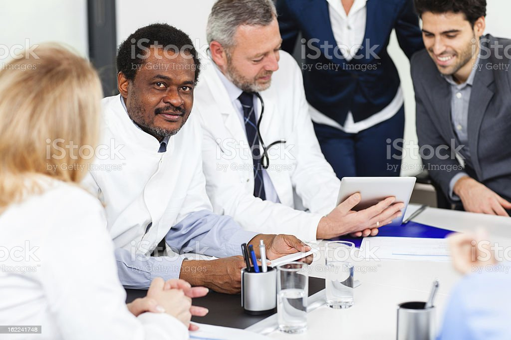 Mature doctor at meeting royalty-free stock photo