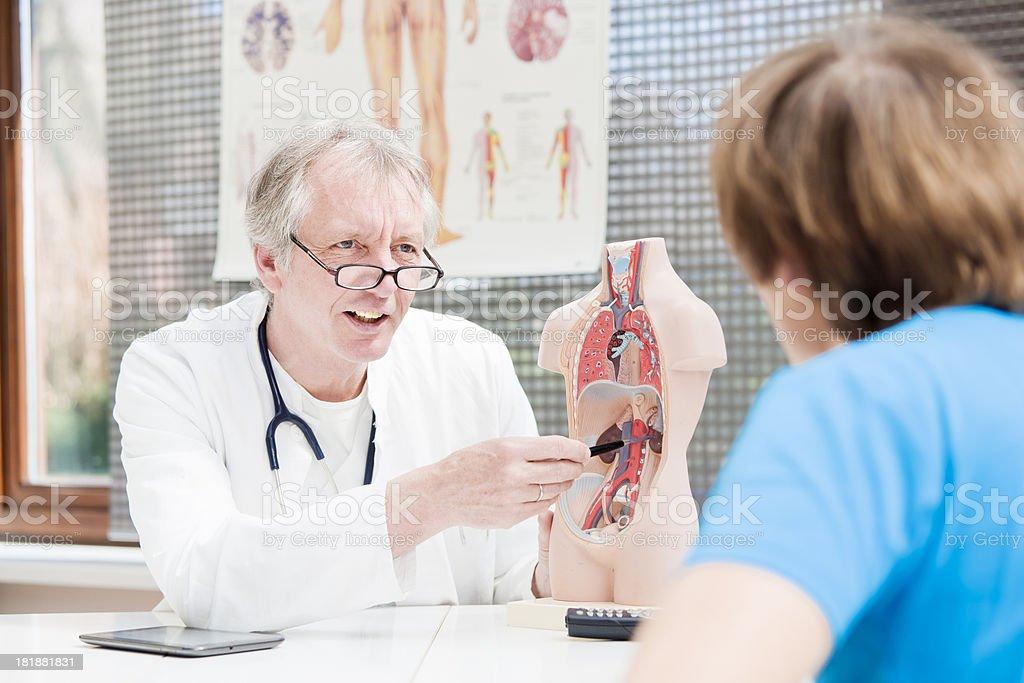 Mature doctor explaining arteriosclerosis stock photo