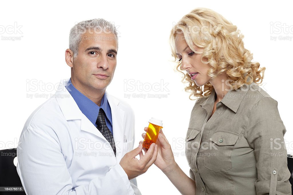 Mature doctor giving medicine to a woman royalty-free stock photo