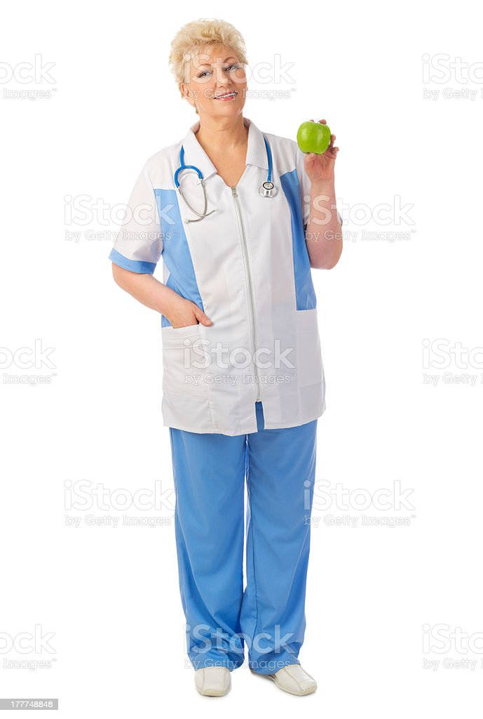 Mature doctor with green apple royalty-free stock photo