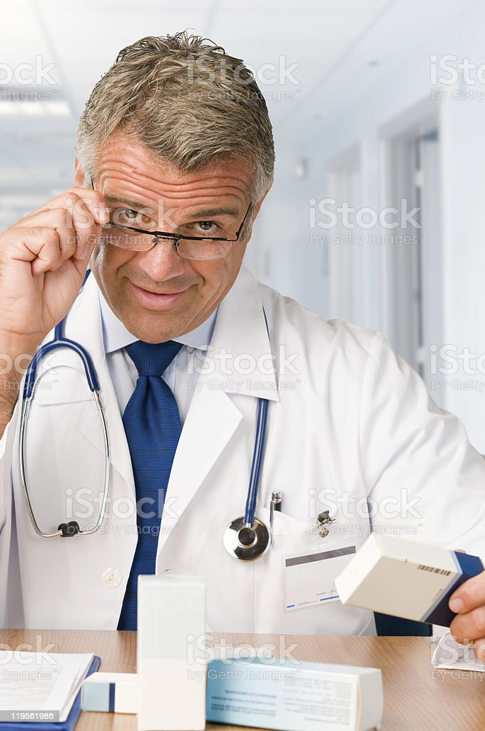 Mature doctor with medicines royalty-free stock photo