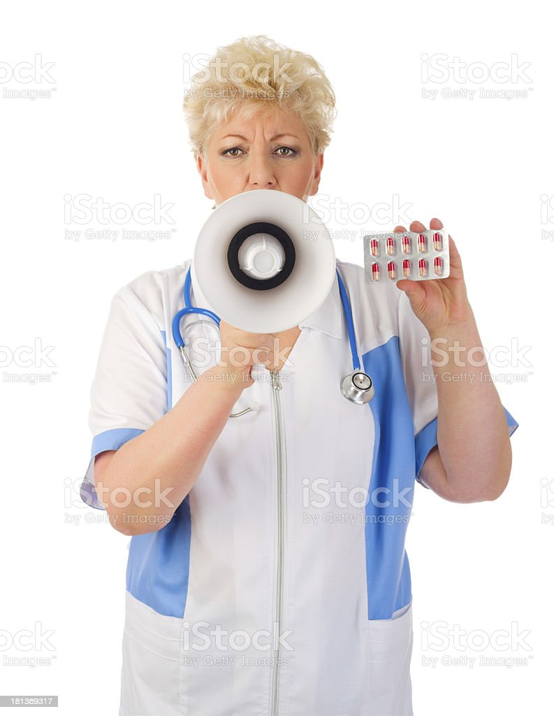 Mature doctor with megaphone and pills royalty-free stock photo