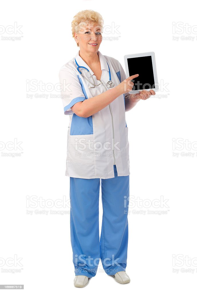 Mature doctor with tablet PC royalty-free stock photo