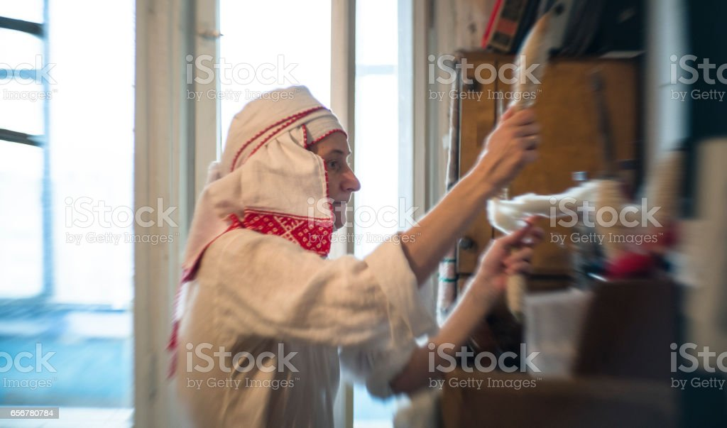 Mature Eastern European, Belarussian woman wearing the traditional dress. stock photo