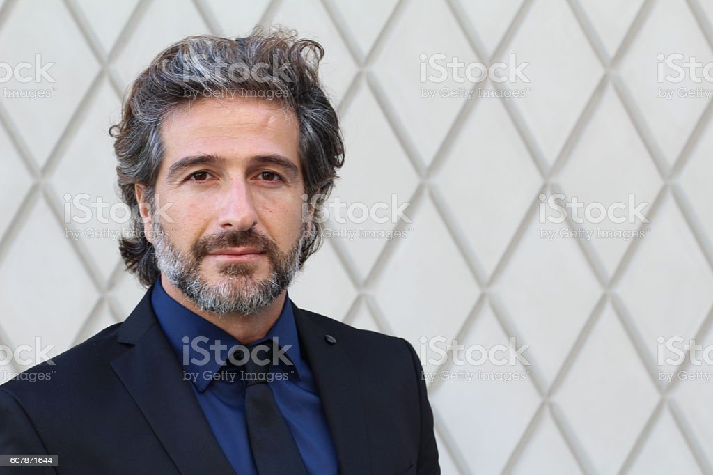 Mature elegant professional standing in the office stock photo
